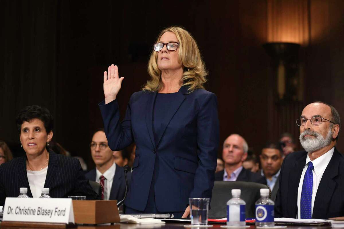 Christine Blasey Ford is sworn in to testify before the Senate Judiciary Committee on Capitol Hill in Washington, Thursday, Sept. 27, 2018, as her attorney's Debra Katz and Michael Bromwich watch. (Saul Loeb/Pool Photo via AP)