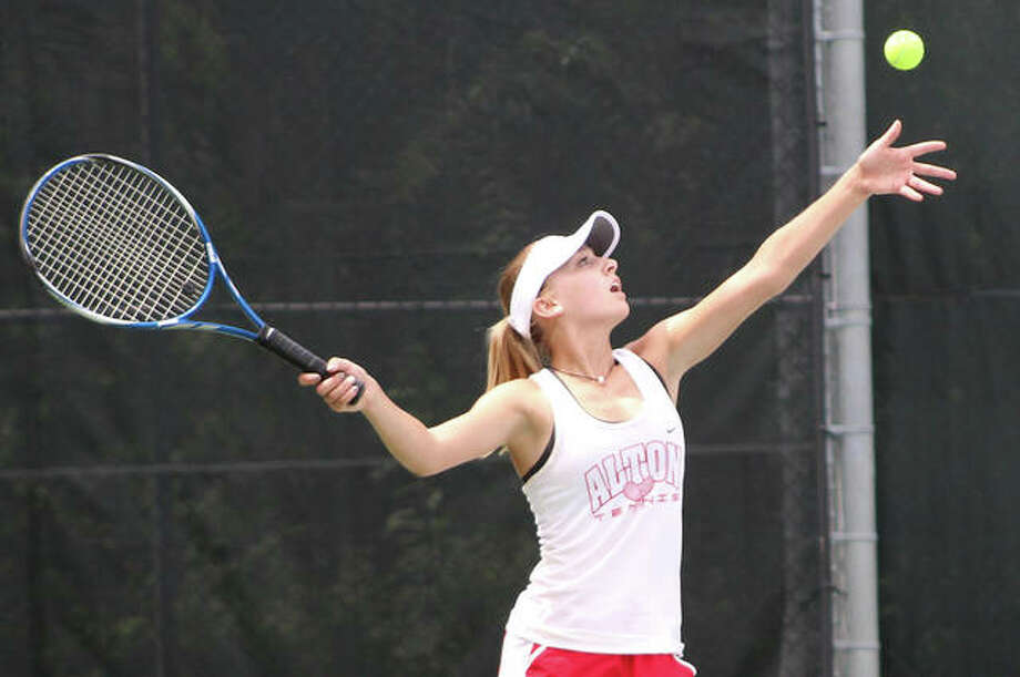 Alton's Ainsley Fortschneider serves during a match earlier this season at the Robert Logan Tournament at LCCC's Andy Simpson Tennis Complex in Godfrey. The Redbirds were at O'Fallon on Wednesday and Fortschneider posted the lone victory in Alton's 8-1 SWC defeat to the host Panthers. Photo: Greg Shashack / The Telegraph