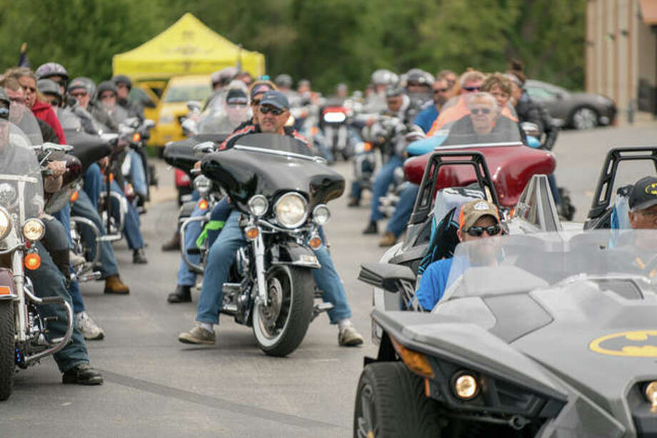 Riders line up for Saturday's Rides for Wishes fundraiser for the Make-A-Wish organization. The annual ride approached $30,000 in funds raised in its fifth year in operation.