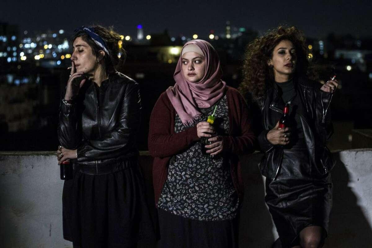 "Mouna Hawa, Sana Jammeliegh, and Shaden Kanboura in ""In Between."""