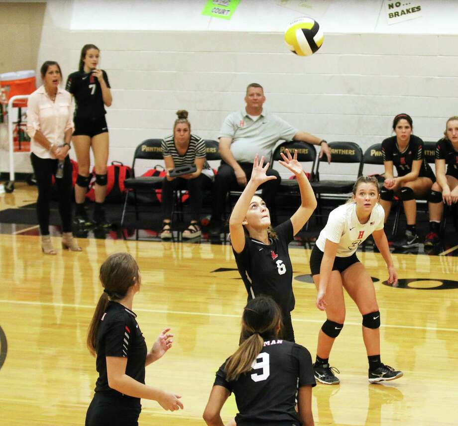 Huffman's Ellie Hayden sets the ball in Tuesday night's win over the Liberty Lady Panthers in three straight sets. The Lady Falcons will host Livingston who is also unbeaten in district. Photo: David Taylor / HCN