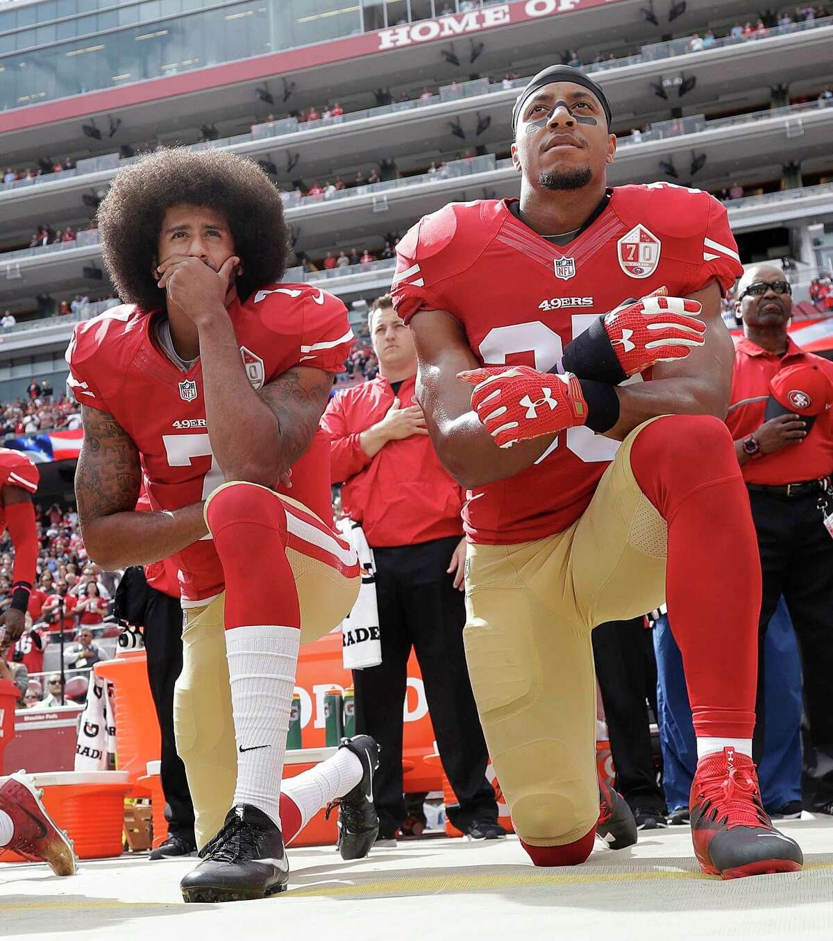 FILE - In this Oct. 2, 2016, file photo, San Francisco 49ers quarterback Colin Kaepernick, left, and safety Eric Reid kneel during the national anthem before an NFL football game against the Dallas Cowboys in Santa Clara, Calif. The Carolina Panthers have signed the free agent safety to a one-year contract. Terms of the deal were not announced Thursday, Sept. 27, 2018.