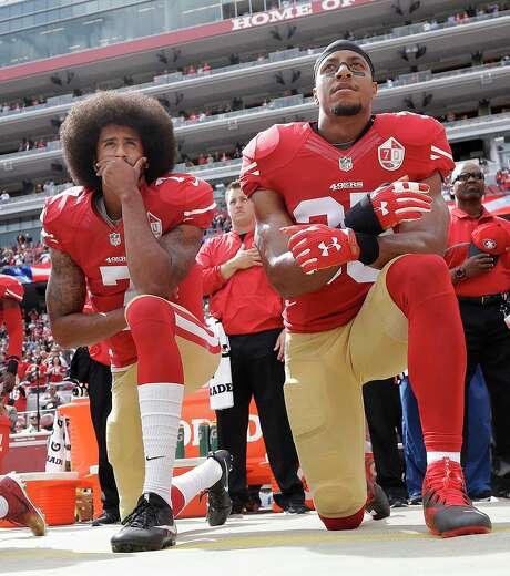 FILE - In this Oct. 2, 2016, file photo, San Francisco 49ers quarterback Colin Kaepernick, left, and safety Eric Reid kneel during the national anthem before an NFL football game against the Dallas Cowboys in Santa Clara, Calif. The Carolina Panthers have signed the free agent safety to a one-year contract. Terms of the deal were not announced Thursday, Sept. 27, 2018. Photo: Marcio Jose Sanchez, AP / Copyright 2016 The Associated Press. All rights reserved.