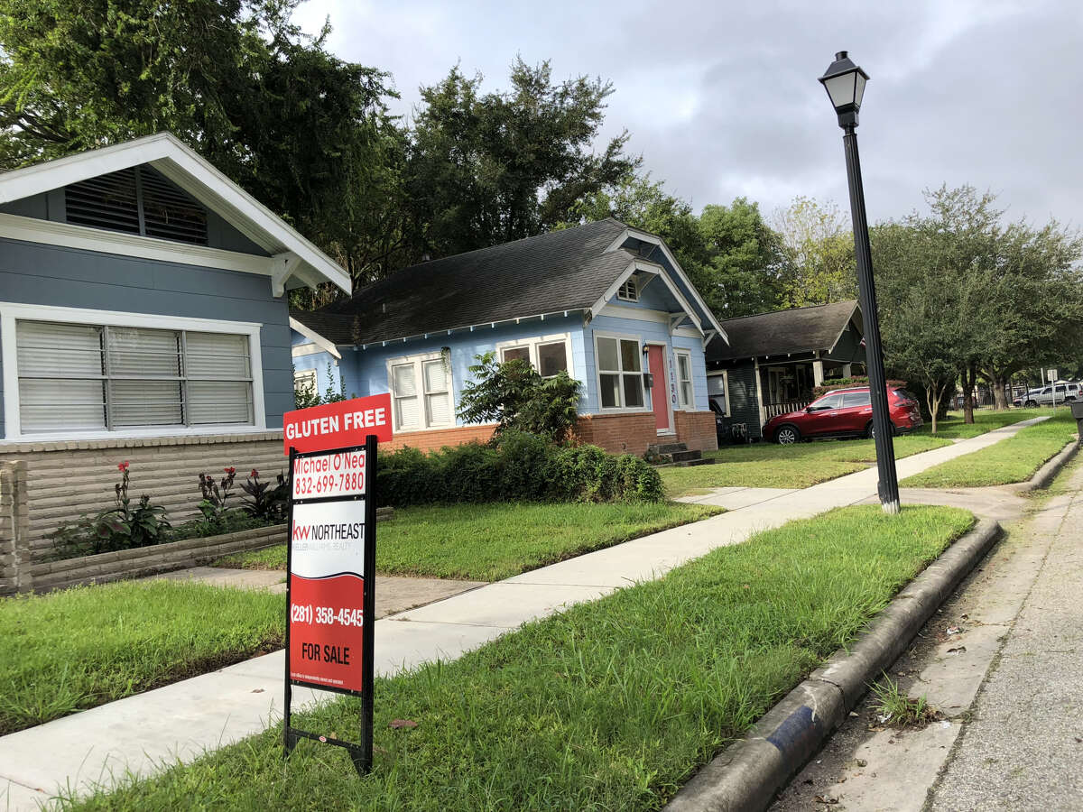 PHOTOS: Catching your eye A house in the Heights Norhill District advertises that it's gluten free. >>Here are some signs that real estate agents use to grab your attention...