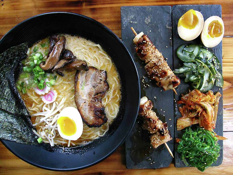 Tonkotsu ramen with pork belly, pickled mushrooms, green onions, fish cakes, sprouts and seaweed sheets, along with chicken yakitori and a pickle sampler with soy pickled eggs, cucumbers, kimchi and seaweed from Kimura Photo: Mike Sutter /Staff File Photo
