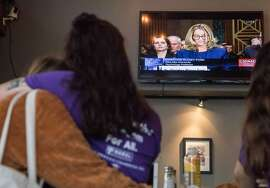 Amelia Furlong of NARAL Pro-Choice California hugs Teresa King of NARAL as they watch Dr. Christine Blasey Ford testify before the Senate Judiciary Committee about her allegations of sexual assault by Supreme Court nominee Brett Kavanaugh during a viewing event at Gaslamp Cafe in San Francisco, Calif. Thursday, Sept. 27, 2018.