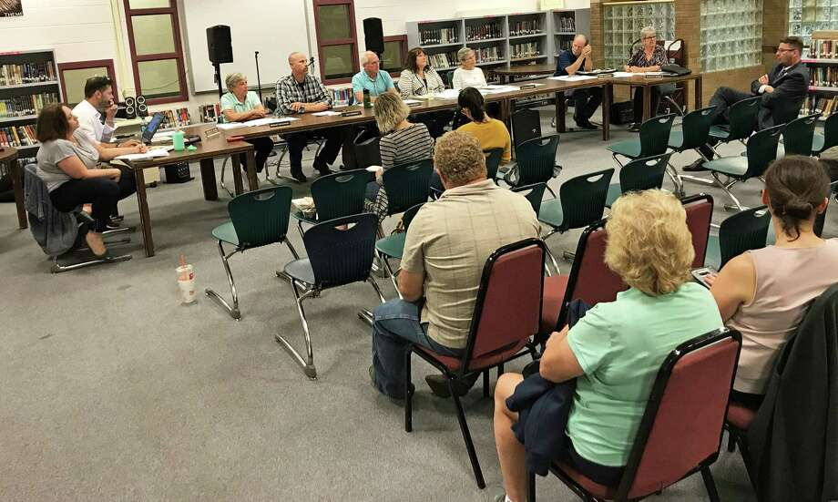 East Hampton Board of Finance members met Wednesday night to hear a budget compromise proposed by the superintendent of schools and town manager. Officials hope the solution will pass after three rejections by taxpayers. Photo: Jeff Mill / Hearst Connecticut Media