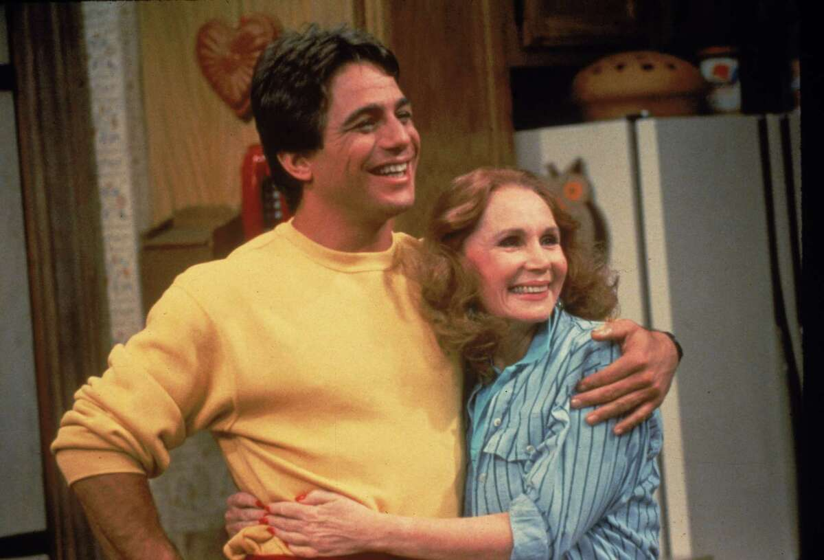 American actor Tony Danza hugs actor Katherine Helmond in a still from the television series, 'Who's The Boss,' circa 1986. (Photo by ABC Television/Fotos International/Getty Images)