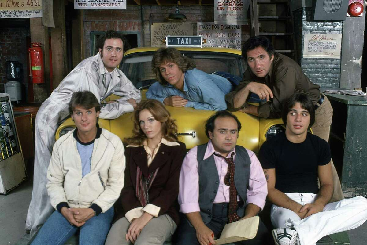 """UNITED STATES - SEPTEMBER 02: TAXI - Gallery - Season One - 9/2/78, Andy Kaufman (as Latka), Randall Carver (as John), Marilu Henner (as Elaine), Jeff Conaway (as Bobby), Danny DeVito (as Louie), Judd Hirsch (as Alex), Tony Danza (as Tony) on the ABC Television Network comedy """"Taxi"""". The staff of a New York City taxicab company go about their job while they dream of greater things., (Photo by ABC Photo Archives/ABC via Getty Images)"""