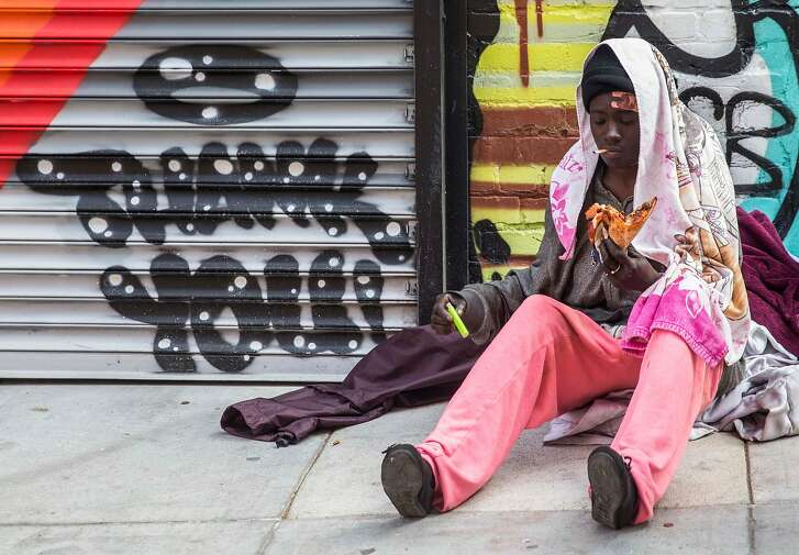 Jennice Mitchell, a homeless woman, eats a slice of pizza from Nob Hill Pizza & Shawarma given to her by Andrea Carla Michaels while she sits in an alley in the Nob Hill district of San Francisco, Calif. Tuesday, Aug. 14, 2018.