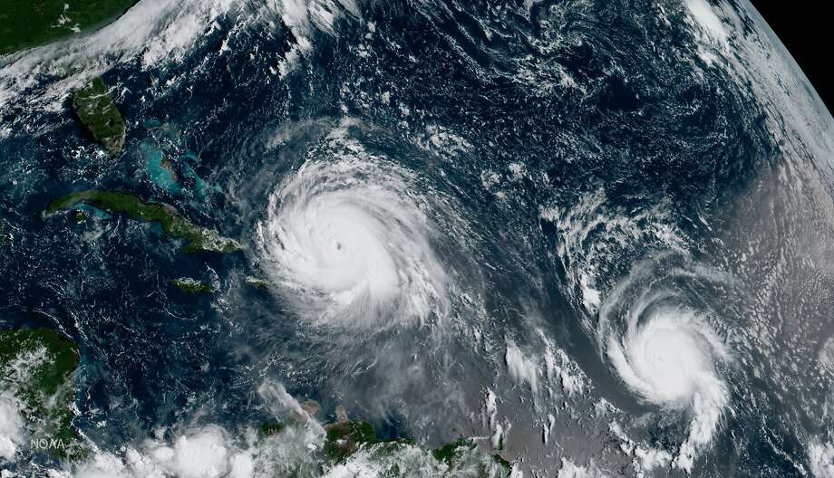 A satellite image shows the eye of Hurricane Irma (left) north of the island of Hispaniola, with Hurricane Jose, right, in the Atlantic Ocean. Six major hurricanes spun in the Atlantic in 2017. Photo: National Oceanic And Atmospheric Administration 2017