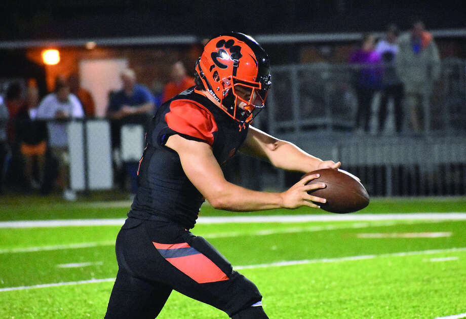 Edwardsville's Brendan Latham prepares to punt the ball away during the third quarter of Friday's game against Alton inside the District 7 Sports Complex. Photo: Matthew Kamp