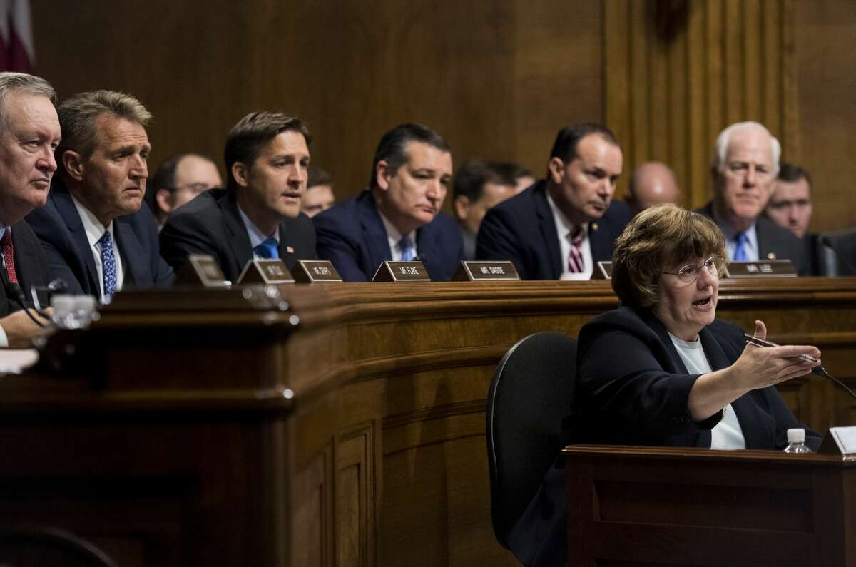 WASHINGTON, DC - SEPTEMBER 27: Rachel Mitchell, counsel for Senate Judiciary Committee Republicans, questions Dr. Christine Blasey Ford as Senators, from left, Mike Crapo, R-Idaho, Jeff Flake, R-Ariz., Ben Sasse, R-Neb., Ted Cruz, R-Texas, Mike Lee, R-Utah., and John Cornyn, R-Texas, listen during the Senate Judiciary Committee hearing on the nomination of Brett M. Kavanaugh on Capitol Hill September 27, 2018 in Washington, DC. A professor at Palo Alto University and a research psychologist at the Stanford University School of Medicine, Ford has accused Supreme Court nominee Judge Brett Kavanaugh of sexually assaulting her during a party in 1982 when they were high school students in suburban Maryland. (Photo By Tom Williams-Pool/Getty Images)