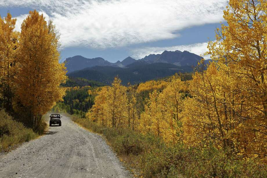 Jeep drives down back road in San Juan Mountains In Autumn Colorado, near Telluride, Ouray and Ridgway in San Miguel County. (Photo by:  Visions of America/UIG via Getty Images) Photo: Joe Sohm/Visions Of America / Universal Images Group Editorial