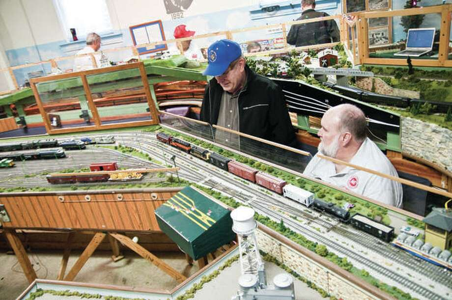 Lindley Renken, left, a model train enthusiast, shares some stories with club member Tom Johnson at a previous open house. Photo: Dan Cruz | For The Telegraph
