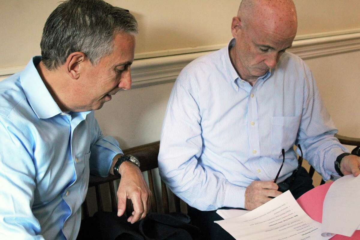 Jay Gross, left, vice chairman of the Strategic Plan Committee, goes over a Board of Selectmen presentation with Chairman John Wynne.