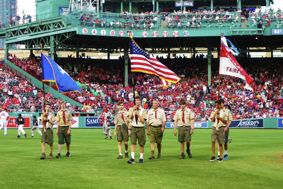 Seven members from Fairfield Boy Scout Troop 82 presented the American and Connecticut flags on the field during the national anthem before a nationally televised game at Fenway Park in Boston. Photo: Contributed Photo