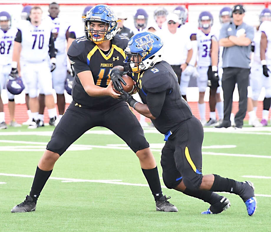 Wayland Baptist sophomore quarterback Nick Quintero hands off the ball to junior running back De'Sean Johnson during the Sooner Athletic Conference opener against Southwestern Assemblies of God on Sept. 15 in Plainview. Photo: Claudia Lusk/Wayland Baptist University
