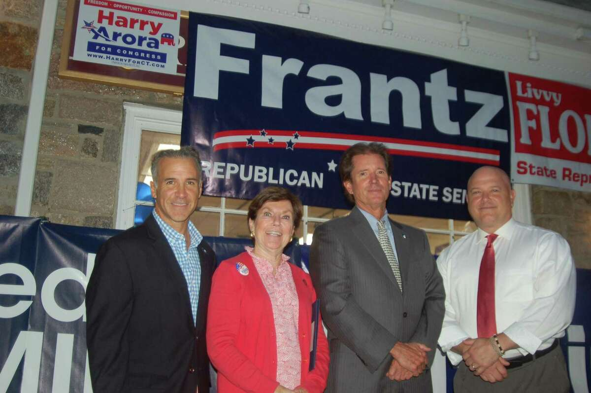 The Greenwich RTC opened its headquarters in Cos Cob on Wednesday night with a full house and many members of the upcoming Republican slate including, from left, State Rep. Fred Camillo, State Rep. Livvy Floren, State Sen. L. Scott Frantz and State Rep. Michael Bocchino, all of whom are running for reelection
