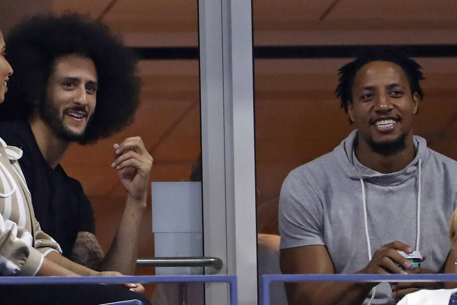 Colin Kaepernick, left and Eric Reid look watch Serena Williams play Venus Williams during the third round of the U.S. Open tennis tournament Friday, Aug. 31, 2018, in New York. (AP Photo/Adam Hunger) Photo: Adam Hunger / Associated Press