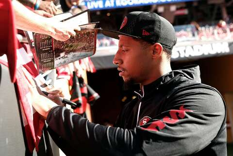 428d44a4b  p San Francisco 49ers  Eric Reid signs an autograph before Niners play the