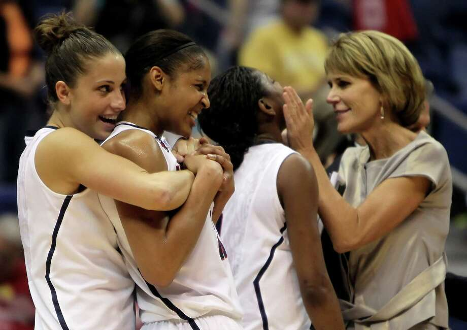 Left to right, Caroline Doty, Maya Moore, Tiffany Hayes and associate coach Chris Dailey of the Connecticut Huskies celebrate following their victory over the Baylor Bears during the Women's Final Four Semifinals at the Alamodome on April 4, 2010 in San Antonio. The Alamodome will host the women's Final Four in 2021. Photo: Jeff Gross /ST / 2010 Getty Images