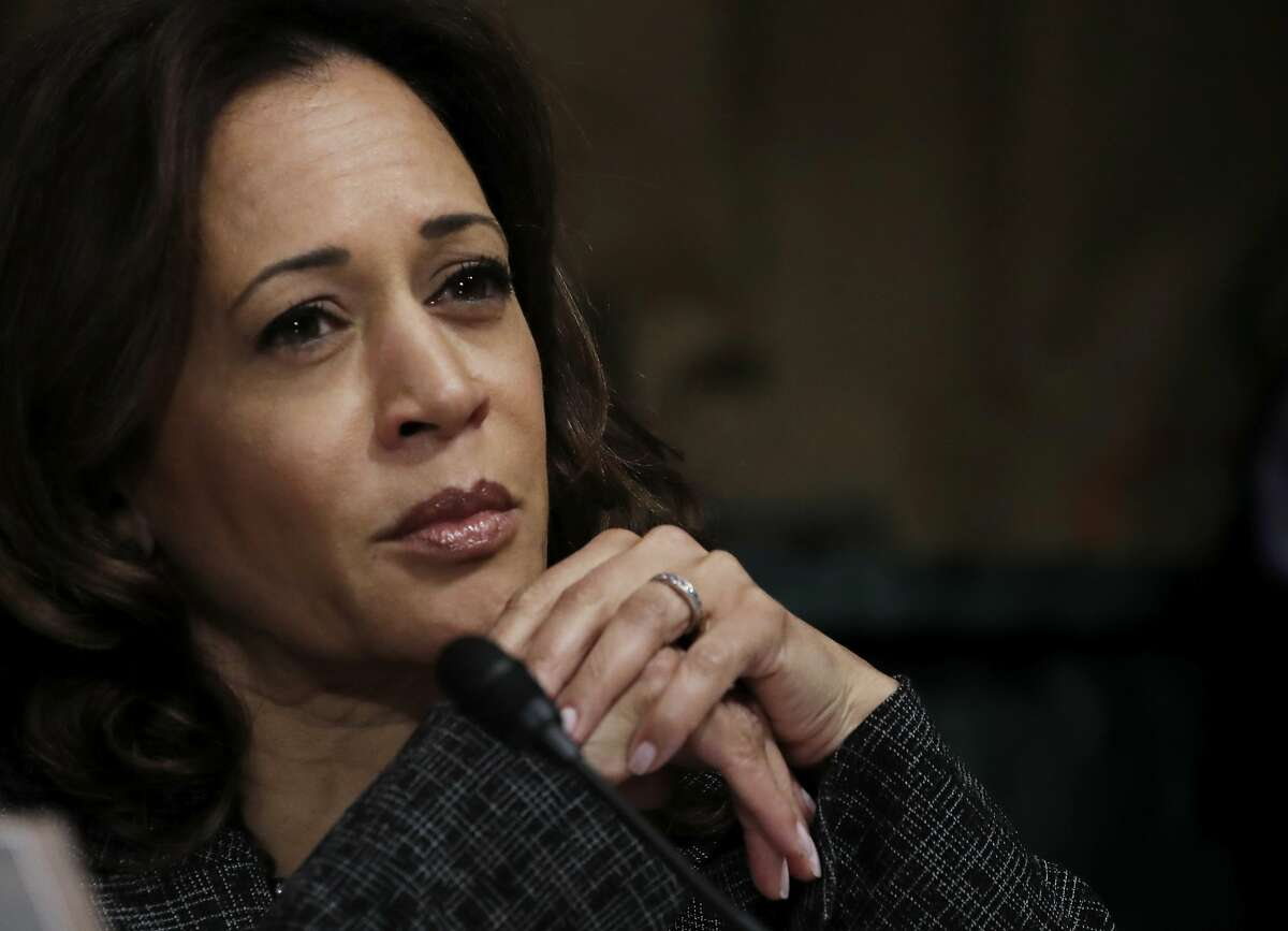 FILE -- U.S. Senator Kamala Harris (D-CA) listens during a Senate Judiciary Committee confirmation hearing with professor Christine Blasey Ford. Fox News mistakenly aired a segment about a shooting on a college campus, showing two photos of Harris in place of the suspect's photo. The network later apologized for its mistake.