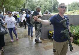 Members of the Texas Patriot Network and other people carry weapons as they protests outside the Islamic Society of North America Convention at the George R. Brown Convention Center, 1001 Avenida de las Americas, Saturday, Sept. 1, 2018, in Houston.