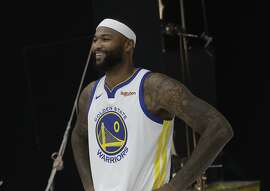 Golden State Warriors' DeMarcus Cousins poses for photos during media day at the NBA basketball team's practice facility in Oakland, Calif., Monday, Sept. 24, 2018. (AP Photo/Jeff Chiu)
