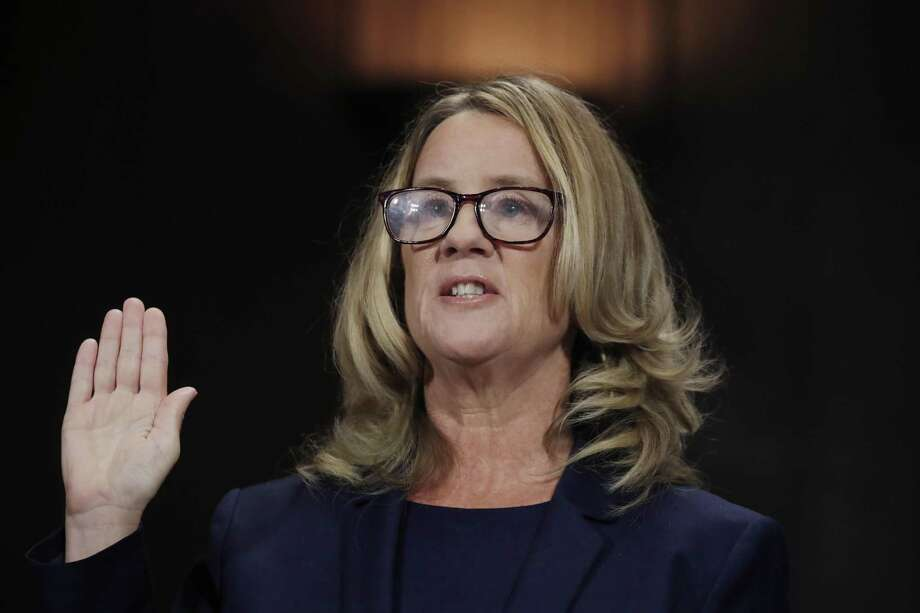 Christine Blasey Ford is sworn in to testify before the Senate Judiciary Committee on Capitol Hill in Washington, Thursday, Sept. 27, 2018. Photo: Jim Bourg / Associated Press / Pool Reuters