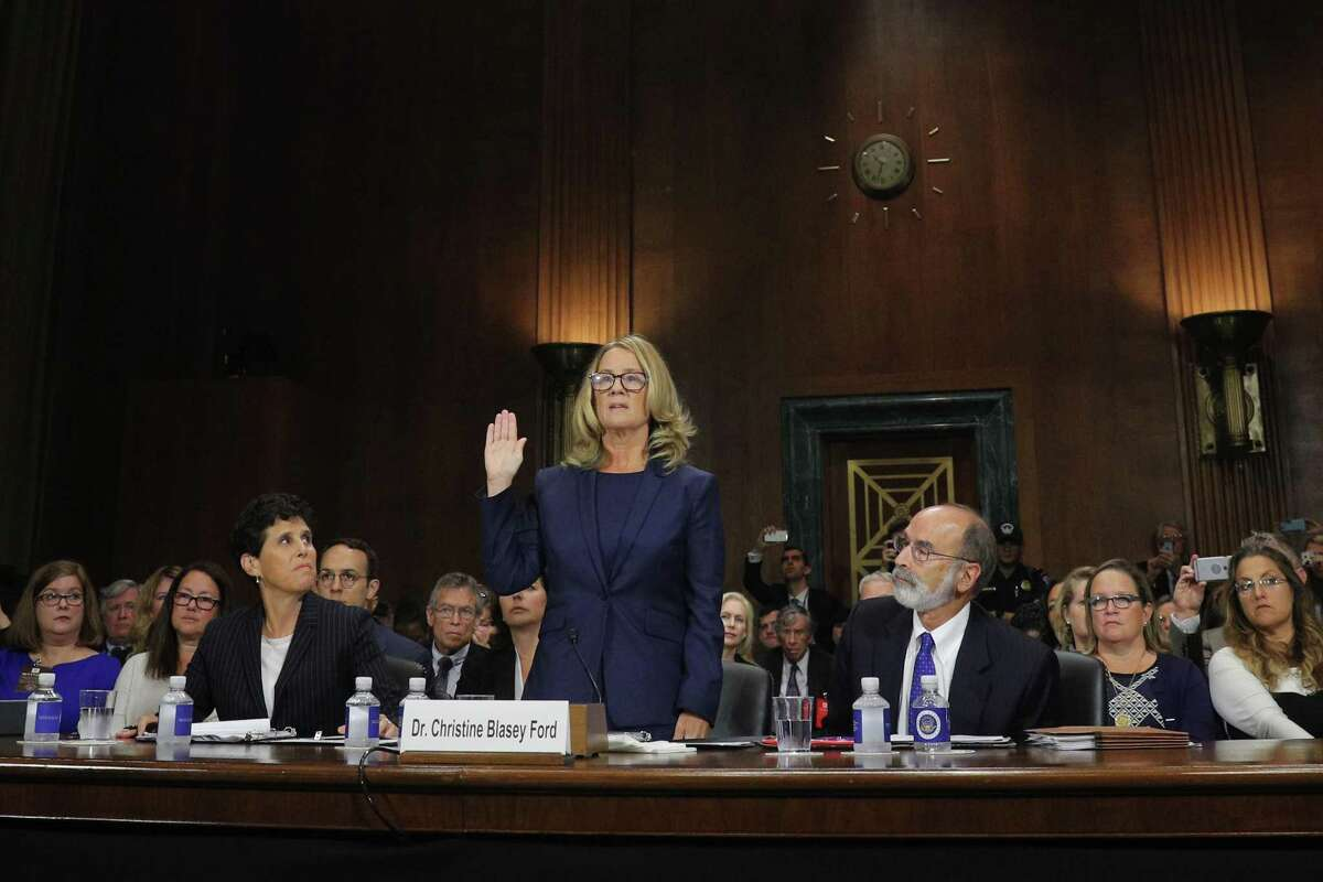 Christine Blasey Ford is sworn in to testify before the Senate Judiciary Committee on Capitol Hill in Washington, Thursday, Sept. 27, 2018.