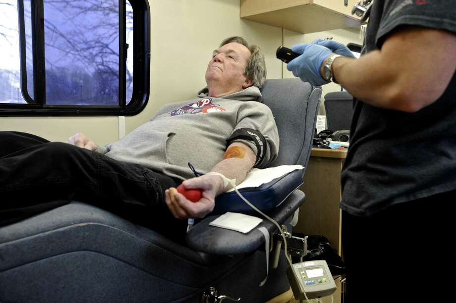 Patrick Patterson, of Sandy Hook, is attended to by Red Cross Phlebomist Chris Banziruk before he donates blood during the Red Cross Blood Drive at the Newtown Municipal Center on Wednesday afternoon, March 1, 2017. 3/2/2017, in Newtown, Conn. Upcoming blood drives : 3/2/2017 in Ridgefield, 1:30 p.m. - 6:30 p.m., at Ridgefield Park & Recreation Center, 195 Danbury Rd. In Bethel 3/3/2017: 1:30 p.m. - 6:30 p.m., at St. Mary's Church, 24 Dodging Town Road, in Danbury 3/10/2017: 1:30 p.m. - 6:30 p.m., at Central Christian Church, 71 West St. In Newtown on 3/7/2017: 1:30 p.m. - 6:30 p.m., at Newtown Congregational Church, 14 West St. 3/7/2017: at 8:30 a.m. - 1:30 p.m., Newtown Congregational Church, 14 West St. Photo: H John Voorhees III / Hearst Connecticut Media / The News-Times