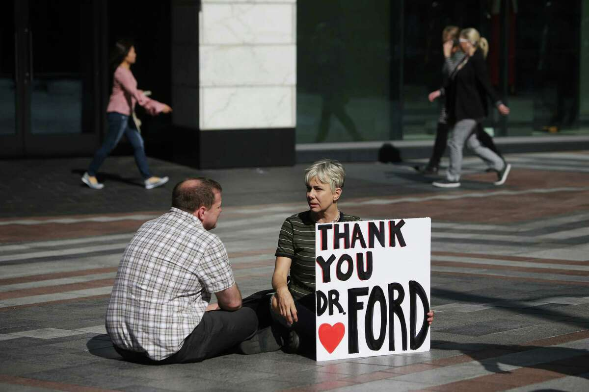 Several dozen people gathered at Westlake Park at noon, Thursday, to show their support for Dr. Christine Blasey Ford as she testifies in a Senate hearing today about her sexual assault allegations against Supreme Court nominee Brett Kavanaugh, Sept. 27, 2018. Many of the people gathered had experience sexual assault themselves and shared their stories. The event ended with a minute of silence in honor of victims of sexual violence.