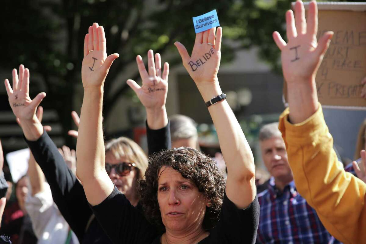 Several dozen people, including Karen Baer (center), gathered at Westlake Park at noon, Thursday, to show their support for Dr. Christine Blasey Ford as she testifies in a Senate hearing today about her sexual assault allegations against Supreme Court nominee Brett Kavanaugh, Sept. 27, 2018. Many of the people gathered had experience sexual assault themselves and shared their stories. The event ended with a minute of silence in honor of victims of sexual violence.