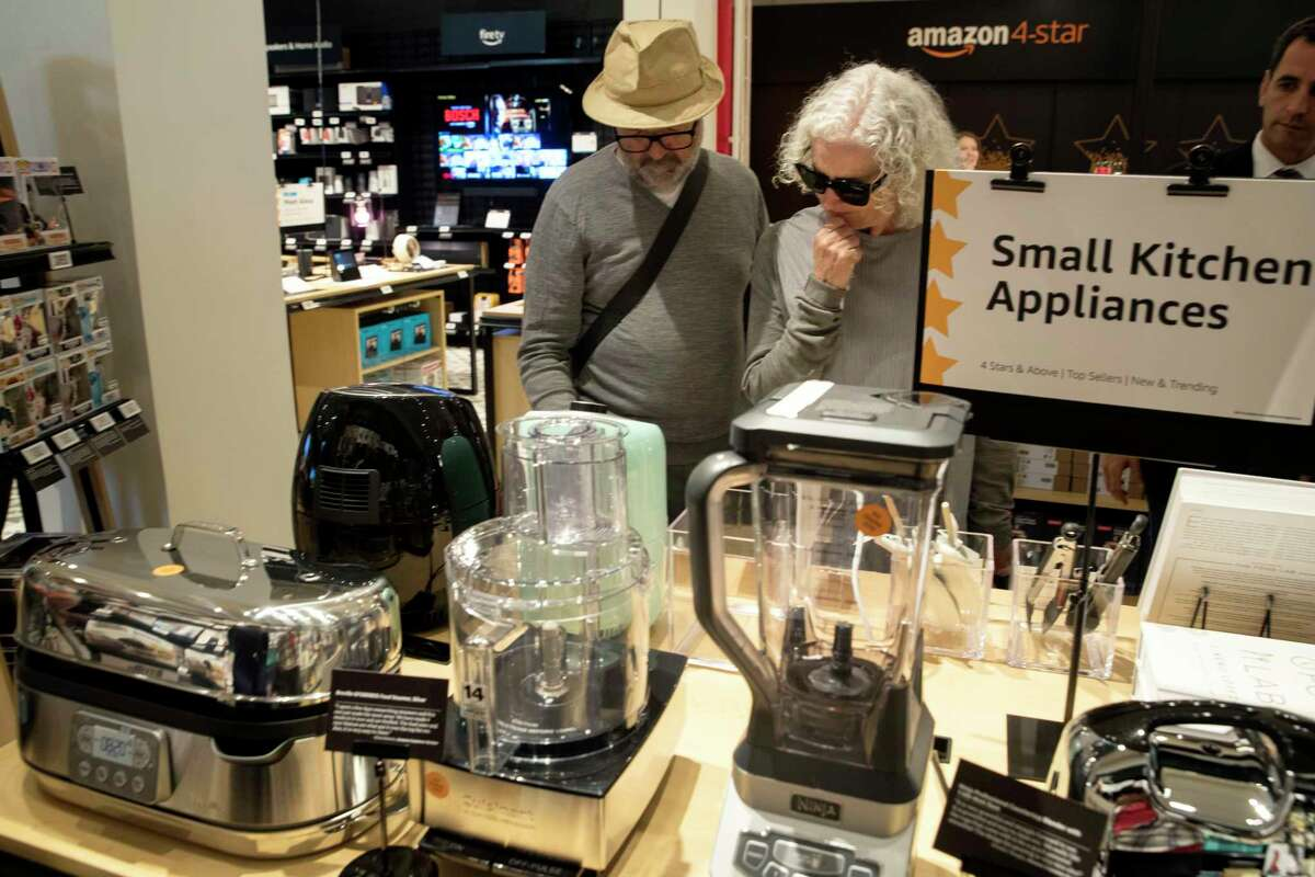 Shoppers browse the items on display at the Amazon 4-star store in the Soho neighborhood of New York, Thursday, Sept. 27, 2018. Amazon is expanding its physical presence again, this time opening a 4,000-square-foot store that sells a wide range of products, including shower curtains, Hallmark cards and baby bottles. (AP Photo/Mary Altaffer)