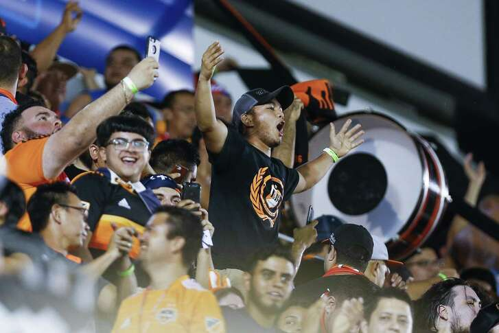 Fans cheer after Houston Dynamo forward Mauro Manotas (9) scored his second goal as the Houston Dynamo take on the Philadelphia Union in the 2018 Lamar Hunt U.S. Open Cup Final at BBVA Compass Stadium Wednesday Sept. 26, 2018 in Houston.