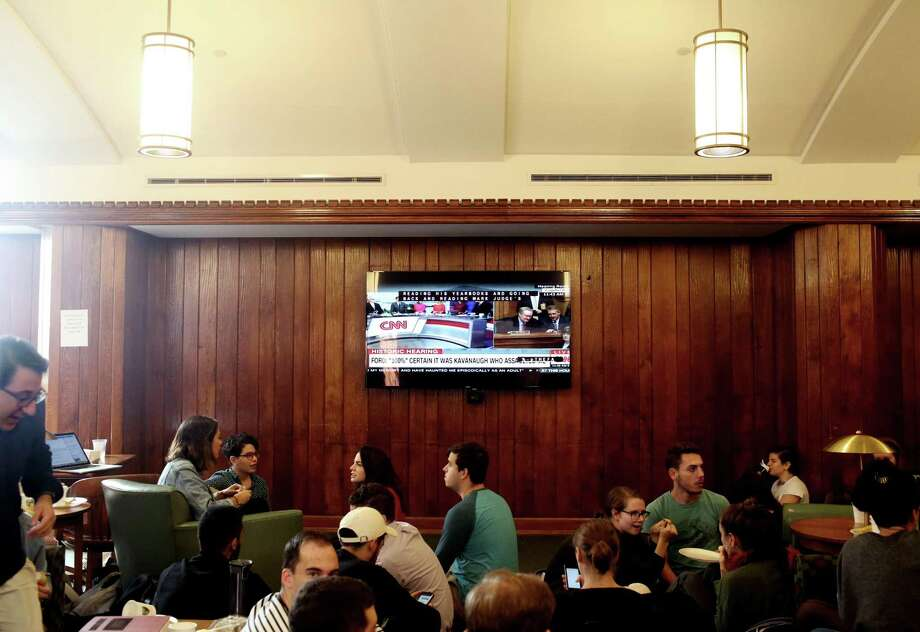 NEW HAVEN, CT - SEPTEMBER 27: Yale University Law School students chat during a break in watching U.S. Senate Judiciary Committee hearings for testimony from Supreme Court nominee Brett Kavanaugh and Dr. Christine Blasey Ford on September 27, 2018 in New Haven, Connecticut. Blasey Ford, a professor at Palo Alto University and a research psychologist at the Stanford University School of Medicine, has accused Kavanaugh of sexually assaulting her during a party in 1982 when they were high school students in suburban Maryland. (Photo by Yana Paskova/Getty Images) Photo: Yana Paskova / Getty Images / 2018 Getty Images