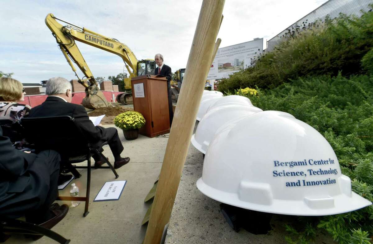 West Haven, Connecticut - Thursday, September 27, 2018: University of New Haven President Steve Caplan speaks during the Bergami Center for Science, Technology, and Innovation Groundbreaking Ceremony Thursday at the University of New Haven. At far left to right are benefactors Lois Bergami and Sam Bergami.