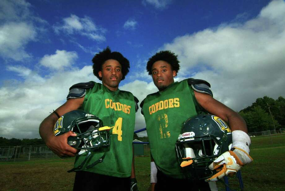 Emmett O'Brien Tech football stars and twin brothers Jonte Roc (4) and Jommar Roc (2) pose during high school football practice in Ansonia, Conn., on Wednesday Sept. 26, 2018. Photo: Christian Abraham / Hearst Connecticut Media / Connecticut Post