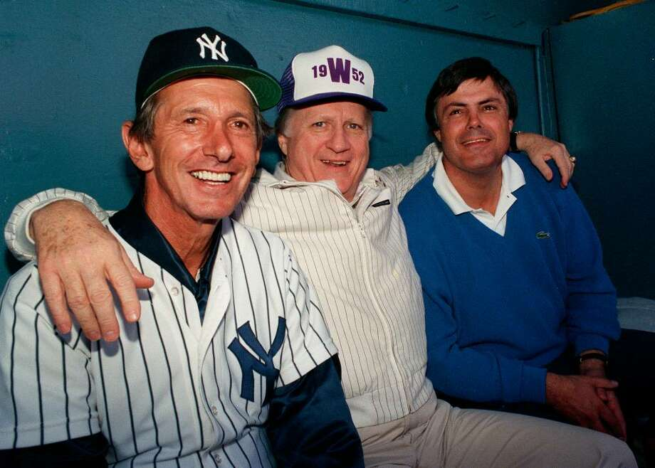 FILE - This Feb. 28, 1998, file photo shows New York Yankees owner George Steinbrenner flanked by manager Billy Martin, left, and vice president and general manager Lou Piniella, right, at spring training in  Fort Lauderdale, Fla. A person close to George Steinbrenner says the Yankees owner died Tuesday morning, July 13, 2010 . (AP Photo/Bill Cooke) Photo: AP