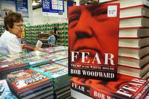 """(FILES) In this file photo taken on September 11, 2018 Veteran journalist Bob Woodward's latest book """"Fear: Trump in the White House"""" is displayed for sale at a Costco store in Alhambra, California on September 11, 2018. - Woodward's incendiary """"Fear: Trump in the White House"""" has become the fastest selling book in Simon and Schuster's history, the publisher said on September 18, 2018, shifting 1.1 million copies in its first week. (Photo by Frederic J. BROWN / AFP)FREDERIC J. BROWN/AFP/Getty Images"""