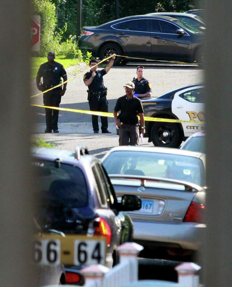 Bridgeport police investigate at the scene of a shooting at a home on Park Terrace in Bridgeport, Conn., on Friday June 29, 2018. Photo: Christian Abraham / Hearst Connecticut Media / Connecticut Post