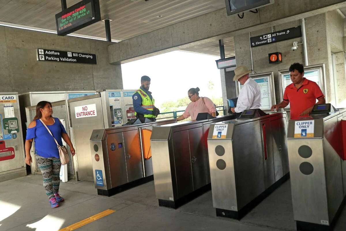 BART riders leave the Pittsburg Center Station. Suburban directors urge more enforcement.