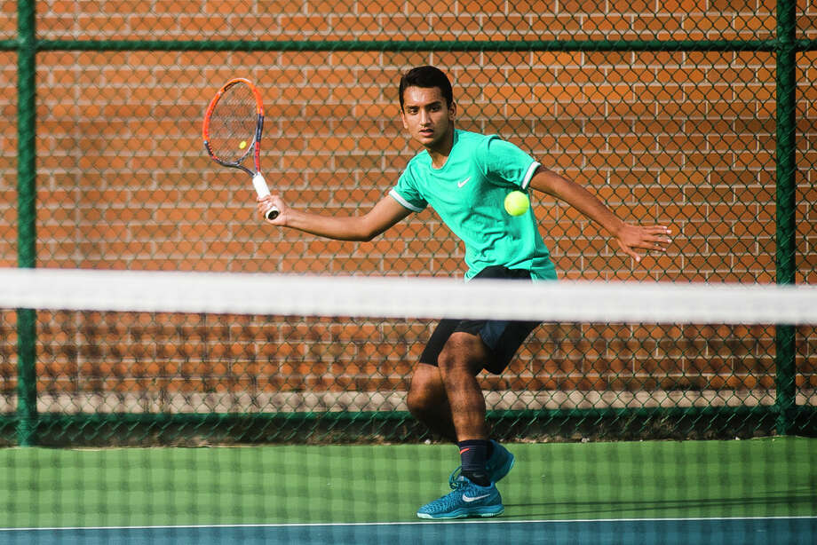 FILE — Dow senior and #2 singles player Anish Middha returns the ball during a match against Midland on Thursday, Sept. 27, 2018 at H. H. Dow High School. (Katy Kildee/kkildee@mdn.netO) Photo: (Katy Kildee/kkildee@mdn.net)