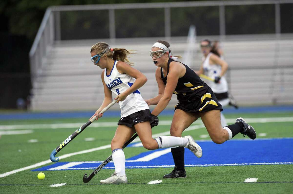 Darien's Molly Hellman holds off Hand's Jessica Murphy during Thursday's game.