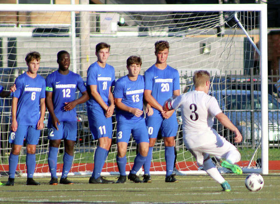 Marquette players form a wall in front of their goal as Lutheran South's Bradley Fritsche (3) takes a direct free kick earlier this week in CYC Tourney action at Lutheran South. From left are Noah McClintock (6), Kwame Ngwa (12), Nick LaFata (11), Kollin Morissey (13) and Conner Noss (20). Marquette won 2-0. Photo: Pete Hayes | The Telegraph