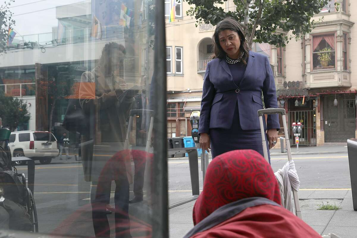 SF Mayor London Breed talks with a homeless man in front of Outfit on Castro Street as she takes a neighborhood walk this morning on Monday, Aug. 13, 2018 in San Francisco, Calif.