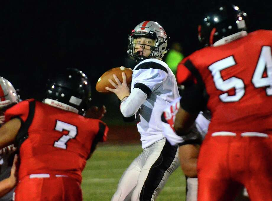 Fairfield Warde QB Joey Gublin looks to pass the ball during high school football action against Central in Bridgeport, Conn., on Thursday Sept. 27, 2018. Photo: Christian Abraham / Hearst Connecticut Media / Connecticut Post