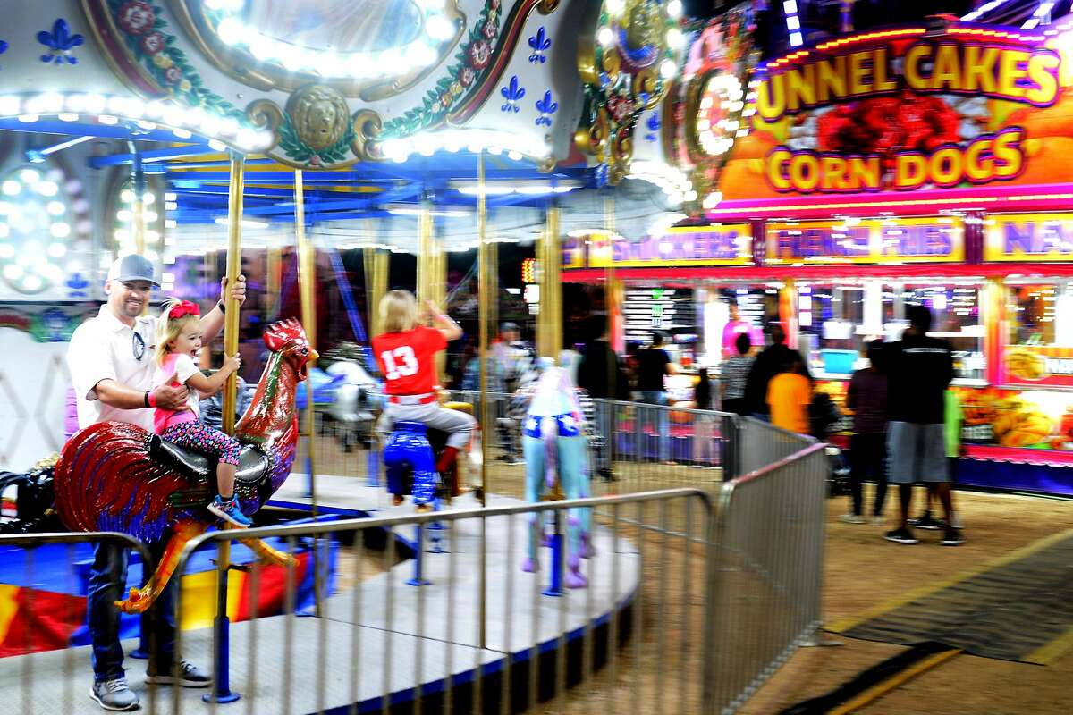 Midlanders enjoy the St. Ann's Fair and Carnival in this Reporter-Telegram file photo