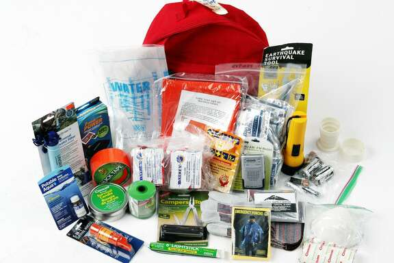 Emergency kit backpack and its contents from a full kit of disaster preparedness supplies -- first aid kit, water, food, blanket, etc., for our special section on how to prepare for disasters such as fires and earthquakes in the Chronicle studio in San Francisco, Calif., Sunday, November 5, 2017.